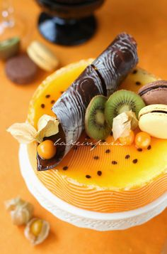 Passion Fruit Entremet. Beautiful! Love the chocolate swirl garnish
