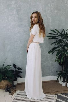 Perfect wedding dress in warm white color. Top and skirt on the floor. Cropped top made of lace, embroidered with beads and sequins. Short sleeves, open back, tie at the back neck. Long puffy chiffon skirt with a thin belt. Dress is made according to individual measurements of the