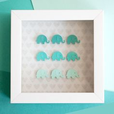 This art project is seriously cute! Learn how to make a shadowbox gift with ombre elephants. This can be modified for any shape!