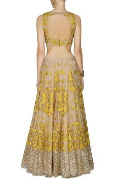 This set features a light peach lehenga in net base appliqued with yellow thread floral embroidery all over the front and back and criss cross sequins border #peachlehengacholiwithyellowembroidery #aasthanarang