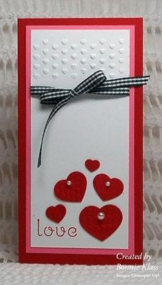 tall slim card. Embossing folder, pearls on the hearts, pink & red mats, black/white ribbon