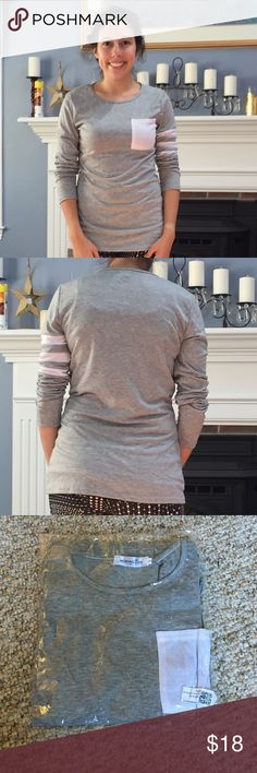 Longsleeve Grey Tee with Pocket/Stripes NEW Brand new 7/8 length tee! Lightweight and perfect for fall. So incredibly cute. Pair with white pants, leggings or jeans. Modeled so you could see style and fit. Yours will be brand new in package AF Tops Tees - Long Sleeve