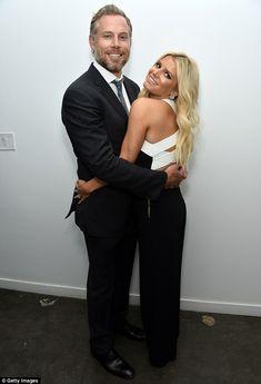 My guy: The cuddly Jessica gave her husband a big warm hug...
