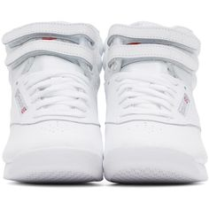 High-top brushed leather sneakers in white. Perforated detailing at round toe and sides. Tonal lace-up closure. Logo patch at padded textile tongue and outer s…