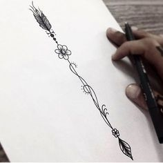 arrow tattoo insp spine (a standard arrow design stands for defense or protection from harm.)