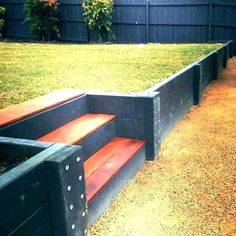 A retaining wall is a perfect DIY project for a variety of skill levels. We have rounded several retaining wall ideas to decorate and build your landscape. Wooden Retaining Wall, Cheap Retaining Wall, Sleeper Retaining Wall, Retaining Wall Steps, Backyard Retaining Walls, Retaining Wall Design, Building A Retaining Wall, Concrete Retaining Walls, Sloped Backyard