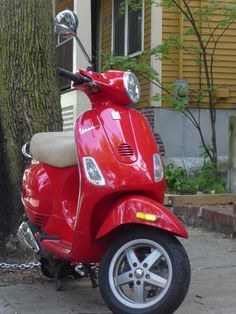 Vespa Dealer 1/2 block from my house. I loved these in Rome... they discontinued the orange, but this red is pretty!