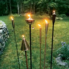 All-weather torches in copper, iron and steel are now available with low-smoke fiberglass wicks and deep, refillable fuel reservoirs. Some can stay lit for up to 20 hours on either standard paraffin lamp oil or bug-busting citronella oil. Photo: Amy Rosenfeld | thisoldhouse.com |