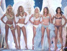Karolina Kurkova, Tyra Banks, Heidi Klum, Gisele Bundchen, and Adriana Lima stood strong during the 2003 Victoria's Secret Fashion Show runway, which was held November 13, 2003, at the Lexington Avenue Armory in New York City. #VSFS #VSFS_2003