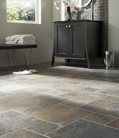 Slate Floor...keeping that same tile in the bathroom, just smaller squares.  Upstairs Hall Bath
