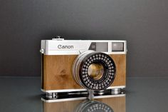 refurbished Canon camera: The Canonet Mansonia. completely hand finished with unique real wood veneer, LED's around the lens for awesome ring light and it comes in bespoke hand made box.