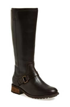 Free shipping and returns on UGG® Australia 'Dahlen' Water Resistant Riding Boot (Women) at Nordstrom.com. A gorgeous, full-grain leather riding boot set on a chunky stacked heel is trimmed with an equestrian-inspired strap and features a water-resistant finish. The cozy lining is crafted from UGGpure, a textile made entirely from wool but engineered to feel and wear like genuine shearling.