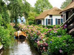 """The tiny town of Giethoorn, Holland, has a sweet secret: its 2,600 residents navigate their picturesque village solely by boat and bicycle. Nicknamed the """"Venice of the Netherlands"""" (did you think that was Amsterdam?) Giethoorn has no roads, but three miles of canals, new bike paths, wooden arch bridges, and thatched farmhouses dating back to the 18th century."""