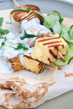 Juicy chicken thighs skewered with grilled Haloumi served with flatbreads, tzatziki and cucumber ribbons.