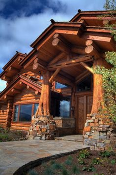 Using the tree trunk and roots for columns in the log home entrance