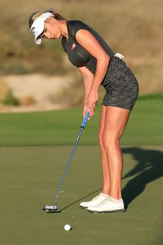 Paige Spiranac Photos Photos - Paige Spiranac of the United States hits a putt for par on the par 3, 15th hole during the second round of the 2015 Omega Dubai Ladies Masters on the Majlis Course at The Emirates Golf Club on December 10, 2015 in Dubai, United Arab Emirates. - Omega Dubai Ladies Masters - Day Two