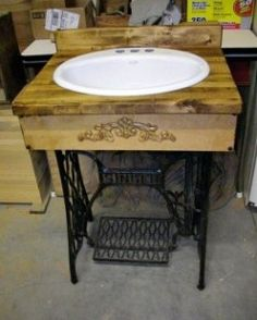 old sewing machine sink--do we already have at least 2 treadle machine cabinets?  lol