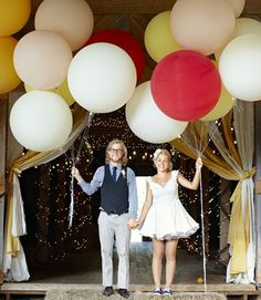 These mega balloons are 36 inches in diameter! Don't miss more cheeky ideas from this carnival-themed wedding reception: http://www.countryliving.com/cooking/entertaining/wedding-reception-ideas