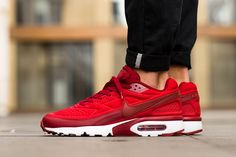 finest selection 1fe17 7d3fb Nike Sportswears SE edition Air Max BW Ultra is currently on the march in  a fresh color combo. Layered in gym red and action red, the kicks are  sculpted i