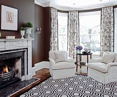 Beautiful moldings and cozy roll arm chairs create an intimate space