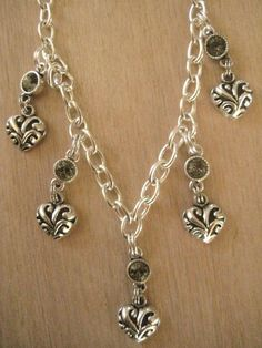 Silver Heart Charm Necklace with Black Diamond Crystals https://www.etsy.com/listing/90147305/silver-heart-charm-necklace-with-black?ref=shop_home_active