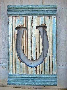 Horseshoe shutter made from recycled wood by woodenaht on Etsy, $28.00
