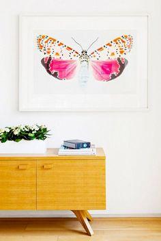 Feminine butterfly art and yellow modern dresser