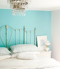 i like the one turquoise wall idea but i wouldnt want white on the other three. maybe a light gray or off white tone
