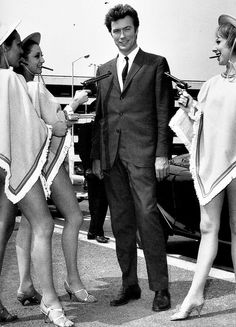 Clint Eastwood arrives at the airport to promote 'A Fistful of Dollars' in London, 1967.