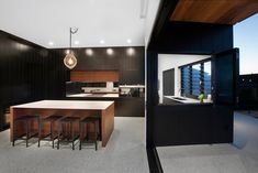 Looking for design inspiration and ideas? Browse Caesarstone's quartz and concetto gallery by collection or application to help visualise your dream renovation. Kitchen Mirror Splashback, Timber Kitchen, Black Color Palette, Engineered Stone, Concrete Design, Polished Concrete, Particle Board, Minimalist Kitchen, Black Kitchens