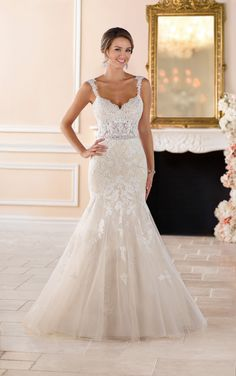 This sexy lace trumpet wedding dress from Stella York is an elegant option for every bride! Lace and tulle over Royal organza is a combination made for a romantic bride. The bodice features lace cut-outs with shimmer sparkles that complement a sweetheart neckline and delicate lace straps. The open back features the same lace cut-outs but leads to a substantial tulle train. The multi-layered tulle in the voluminous skirt is adorned with luxe lace details and horsehair trim for extra fullness…