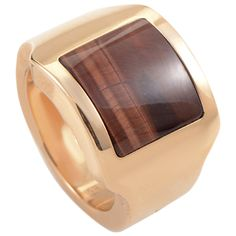 Cartier Santos Tiger's Eye Gold Ring | From a unique collection of vintage band rings at https://www.1stdibs.com/jewelry/rings/band-rings/