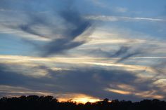 Wispy clouds in front of the setting sun. #clouds #sunset
