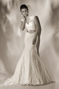 """TAYLOR Style: 12818 Fabric: LACE  """"A STUNNING FIT AND FLARE GOWN FEATURING A CAPTIVATING NECKLINE, CAPPED SLEEVES AND KEYHOLE BACK ACCENTED WITH A ROMANTICALLY BEADED BELT."""""""