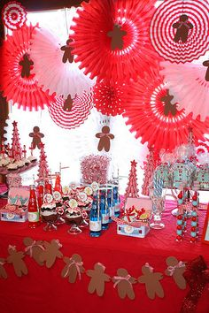 Gingerbread Party. Love all the hanging fans with the gingerbread men in them.