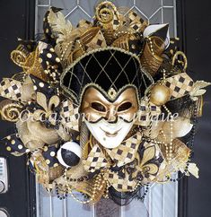 Mardi Gras Wreath, Mardi Gras Decoration, Front door Wreaths, Door Hanger, Wreath for door, Made to Order This Mardi Gras wreath is made with layered loops of shimmering gold deco mesh, and accented with metallic black and gold deco mesh ruffles, high quality wired ribbon, hand