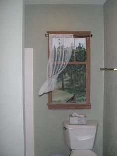 A nice idea for a windowless bathroom. Trompe l'oeil window