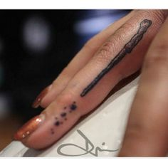 14 Very Cool Harry Potter Tattoo Ideas. Love this one maybe light saber for Star Wars, staff for LOTR, wand for Harry Potter.