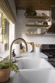 Brass kitchen faucet, open shelves, kitchen inspo.