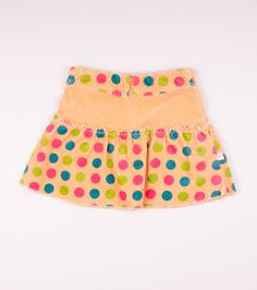 Skirt with elastic band (with two buttons) at waist. Pattern with big, color dots . Zip fastening at back.
