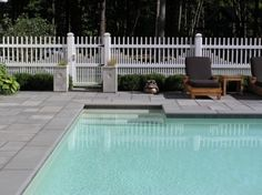 Safety first for the little ones and looks nice! Vinyl picket pool fence