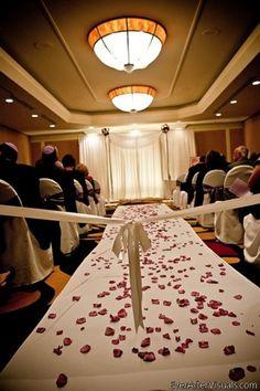 Romantic rose petals cover the wedding ceremony aisle at Hilton Arlington. {Hilton Arlington}