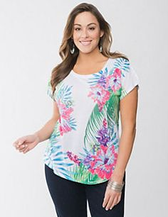 Ultra-trendy for the season, our high-low top has you ready for summer stylin' with an embellished floral and palm print. Cute & colorful with cap sleeves and scoop neck.
