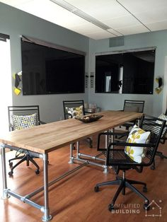 need a big screen like this - pillows make the room comfier - like the paint color - basically I think this space is great (Diy Bar Height) Modern Office Table, Modern Office Design, Church Interior Design, Home Interior, Office Paint Colors, Office Decor, Office Ideas, Conference Table, Pipe Furniture