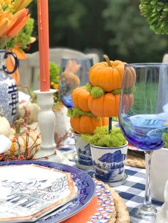 Great pumpkin floral arrangement for a fall party or Friendsgiving. Love the idea of using these pumpkin topiaires for a Thanksgiving Party and mixing in some blue and white chinoiserie! Fall Tablescape Ideas with Old Southern Charm Fall Table Settings, Thanksgiving Table Settings, Thanksgiving Parties, Pumpkin Floral Arrangements, Orange Table, Pumpkin Topiary, Chinoiserie Chic, Tablescapes, Fall Decor