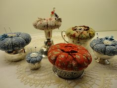 pincushions on silver stands.