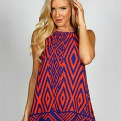 Blue and Orange Dress! This dress is super cute, no need to wear a slip, its not see through! 32 inches, 100% poly red and white picture is to show the back view! Dresses