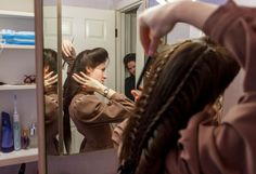 Heidi Holm does her hair in Colorado City. Holm and her sister Helen (at rear) recently left the FLDS church. photo by Trent Nelson via  stylin'