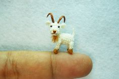 Not a real goat, but you can find this little guy @ http://www.etsy.com/shop/suami