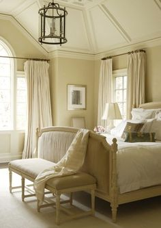 love the scale and the peaceful quality of this bedroom...lighting and ceiling detail